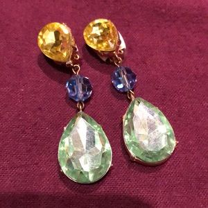 Drop earrings in yellow, blue, and green colors.